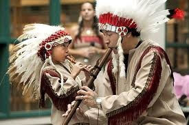 native american son and father in costume